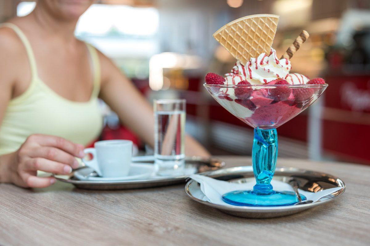 Frozen Yogurt with berries whip cream in martini glass